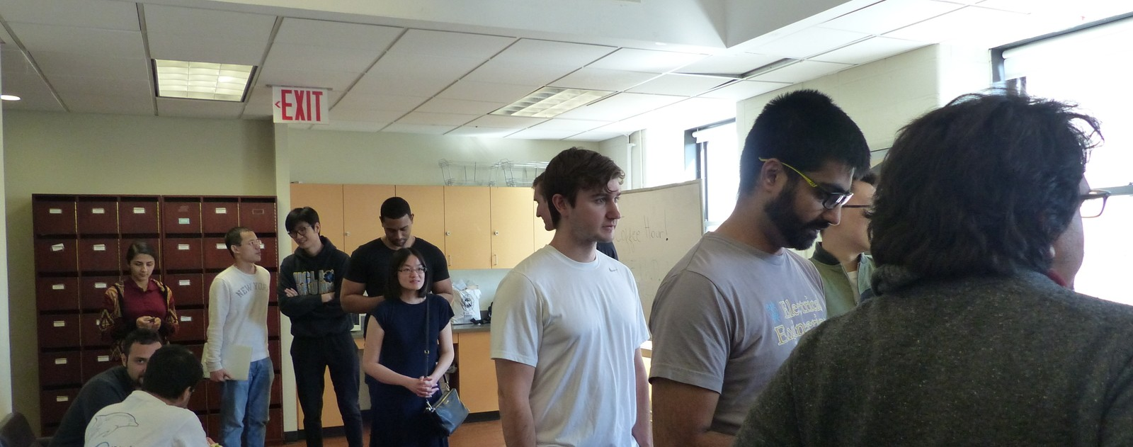 Graduate electrical engineering students lining up for lunch during a mid-semester get-together
