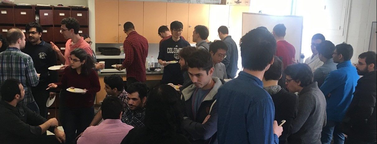 Graduate electrical engineering students taking a coffee break mid-semester