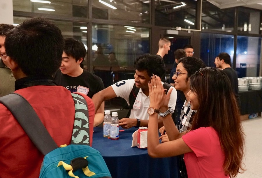 Graduate electrical engineering students engaging in ice breakers during the kick-off event